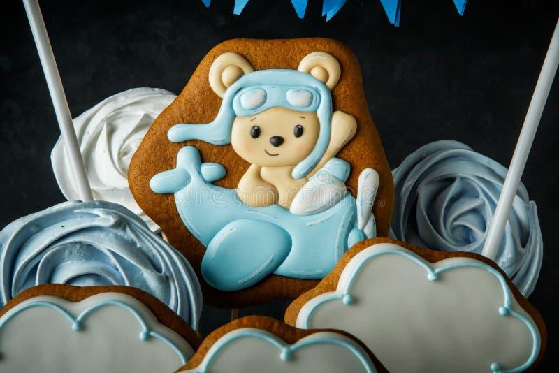 Horizontal view sky theme decoration of birthday cake. Horizontal view cloud-shaped gingerbread, zephyr and bizet as birthday cake decoration on sky theme stock photo