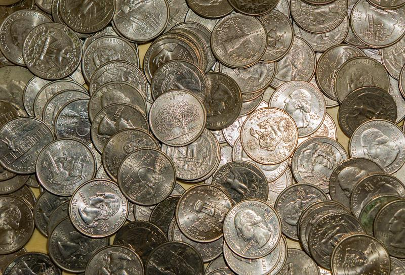 United States Quarters Coins. Horizontal view of different types of United States quarter coins ideal for business or background royalty free stock photography