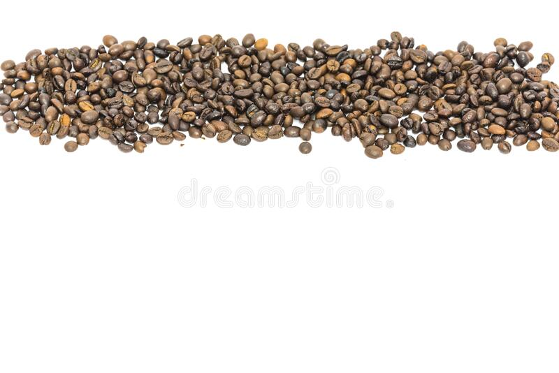 Horizontal view heap of roasted Vietnamese robusta coffee beans isolated. Panorama heap of roasted Vietnamese robusta coffee beans isolated on white background royalty free stock images