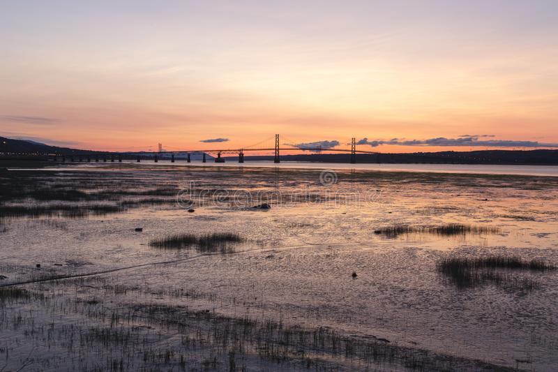 Horizontal view of the 1935 Island of Orleans Bridge over the St. Lawrence River. Seen from the Beauport area of Quebec City during a summer sunrise, Quebec royalty free stock images
