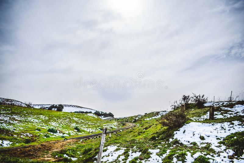 Algeria winter nature landscape. Horizontal view of medea benchkaou landscapes with abandoned old woody railway royalty free stock photos