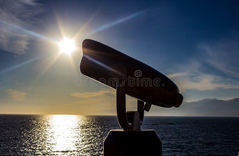 Periscope view of starburst over ocean stock image