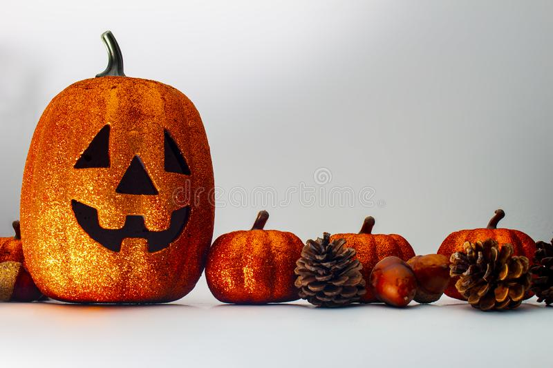 A horizontal view of pumpkin and ornaments on a white background. With space for text and graphics royalty free stock photo