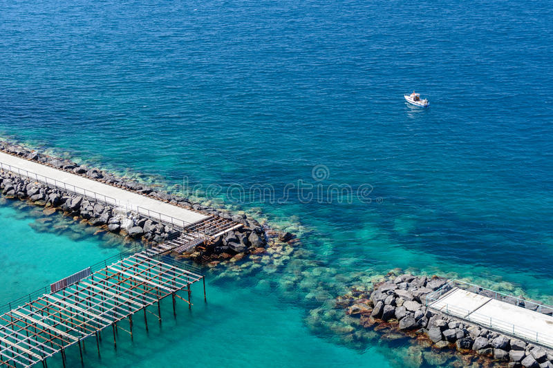 Horizontal view of rocky shores in the sea. Long exposure shot w royalty free stock photos