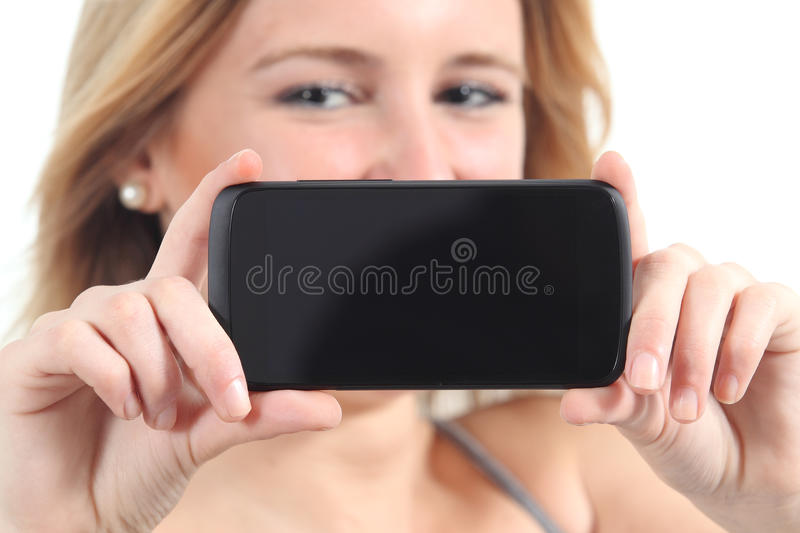 Horizontal view of a woman showing a black smartphone screen stock image