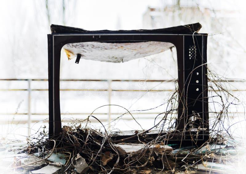 Horizontal vintage broken tvset in radioactive pripyat bokeh bac royalty free stock photography