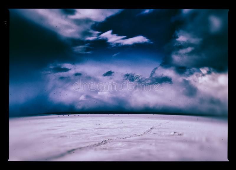 Horizontal vintage winter frozen lake landscape background. Orientation nobody blank empty space sparse vivid vibrant bright color rich composition design royalty free stock photos