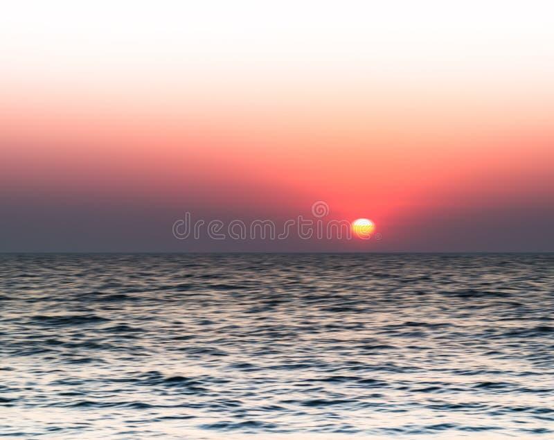 Horizontal vivid burning sunset blur abstraction. Background backdrop stock photo