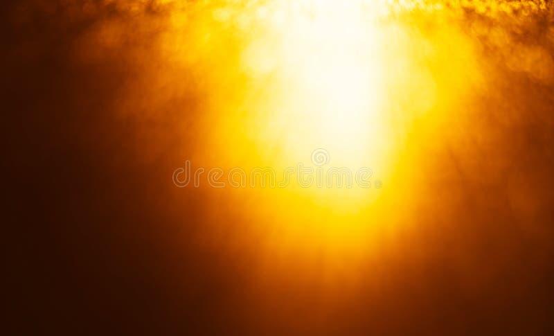 Horizontal vivid orange glow light leak from above bokeh backgro royalty free stock image
