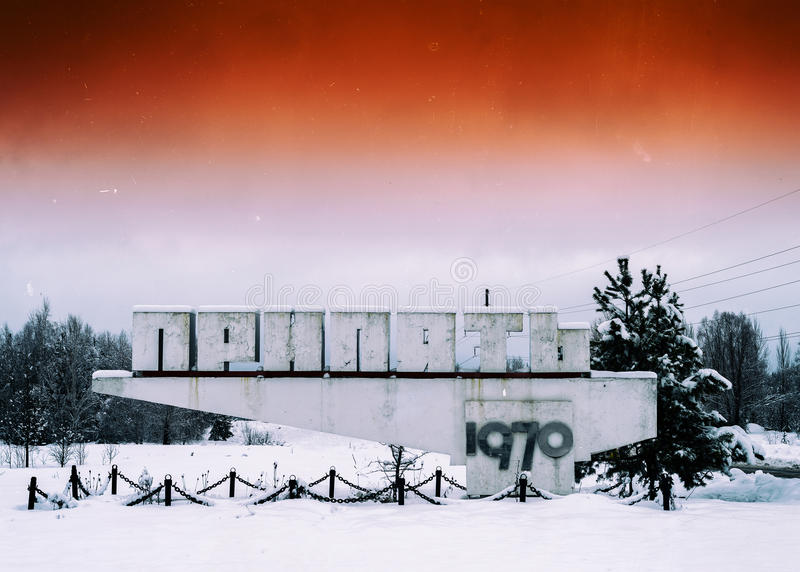 Horizontal vivid orange radioactive Pripyat town sign. Horizontal vivid orange vintage radioactive Pripyat town sign background backdrop royalty free stock image