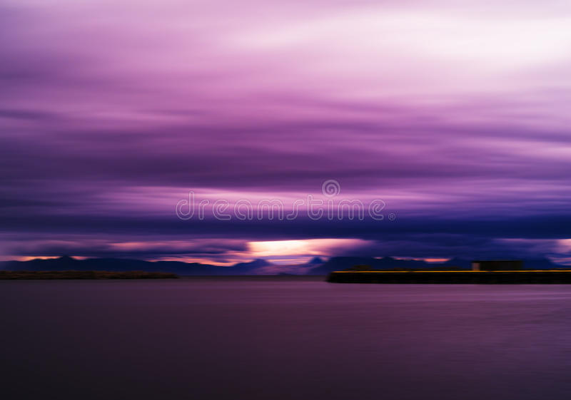 Horizontal vivid vibrant pink purple Norway landscape cloudscape abstraction backdrop background royalty free stock photo