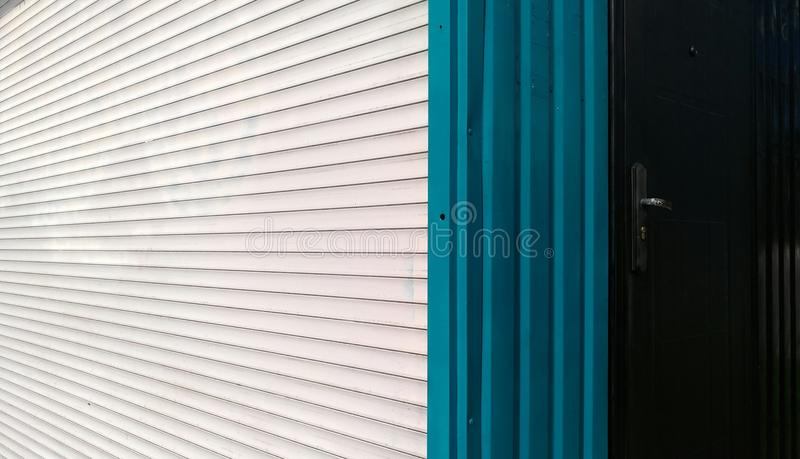 Horizontal white and blue vertical stripes of metal blinds royalty free stock image