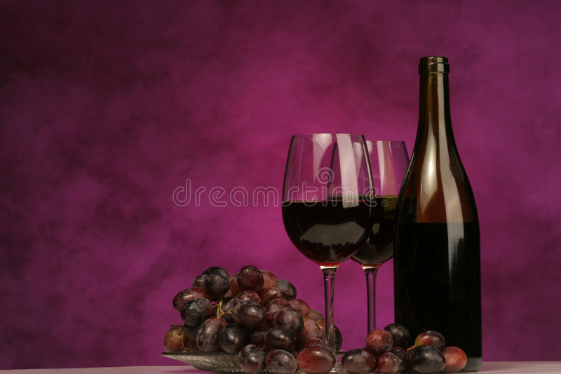 Horizontal of Wine bottle with glasses and grapes stock photography