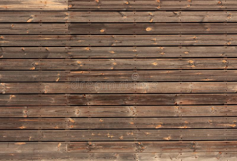 Horizontal wooden boards tinted in brown color royalty free stock image