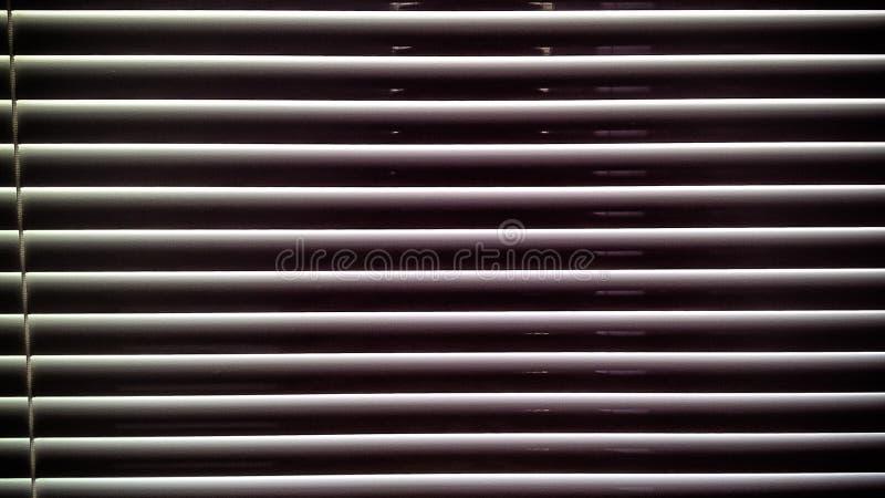 Horizontale Streifenmustervorhänge stockbilder