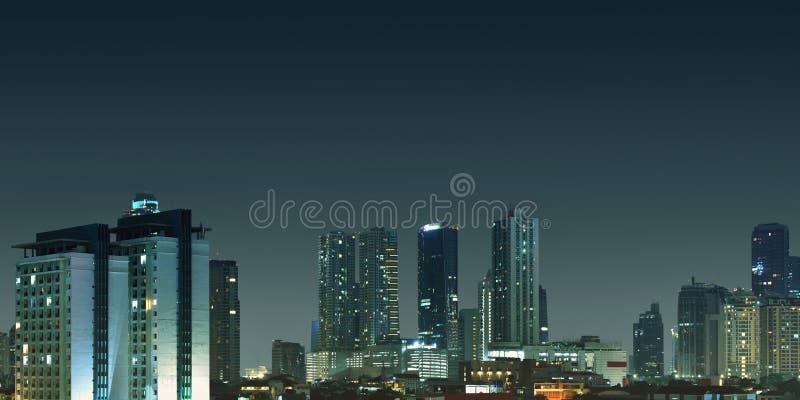 Horizonte de la ciudad de Jakarta en las noches foto de archivo