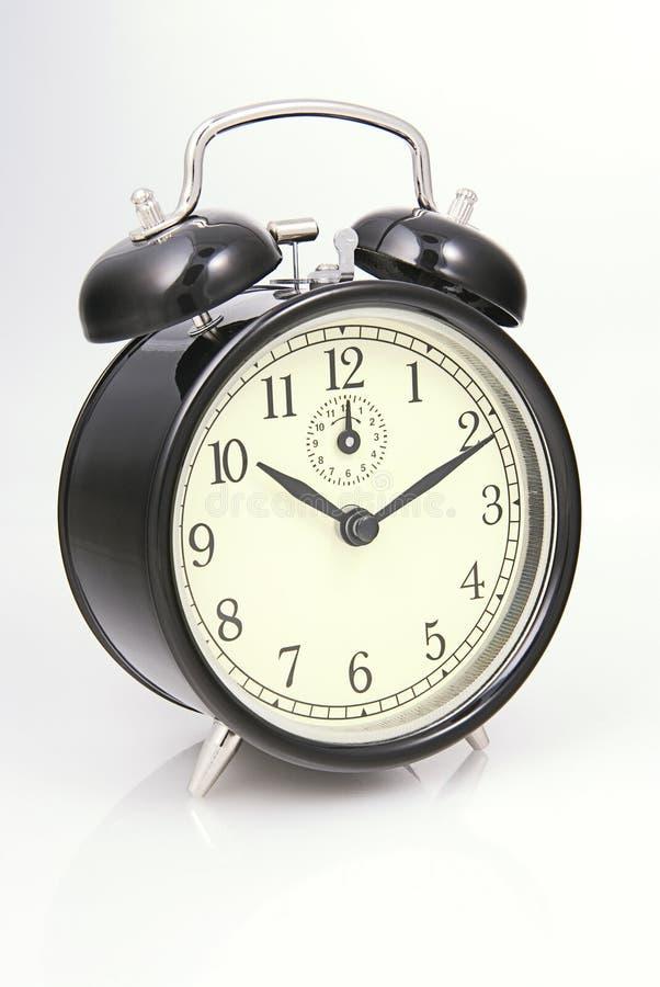 Horloge d'alarme d'isolement au-dessus du blanc photo libre de droits