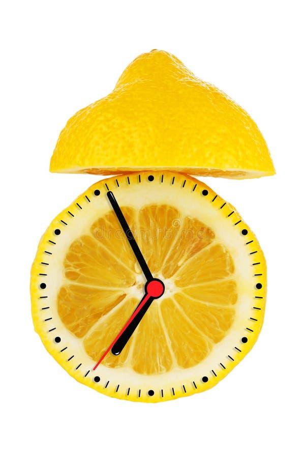 Horloge d'alarme de citron photographie stock libre de droits