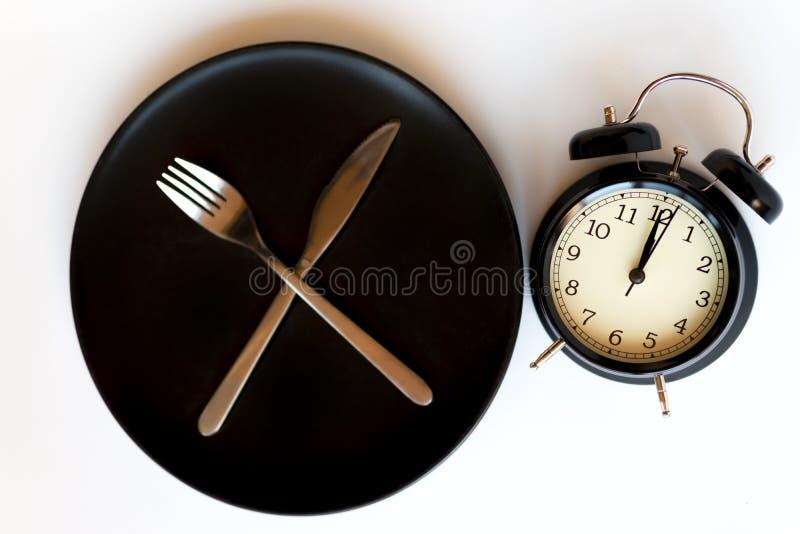 Horloge d'alarme noire image stock