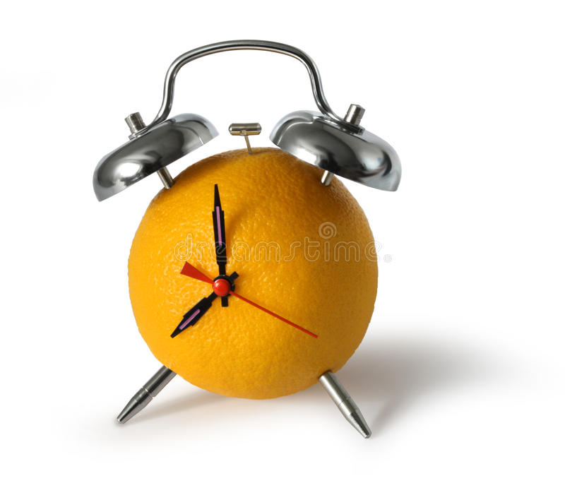 Horloge d'alarme orange fraîche de fruit images libres de droits