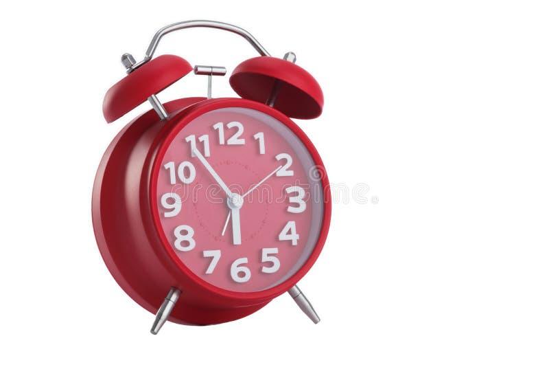 Horloge d'alarme rouge sur le fond blanc image libre de droits