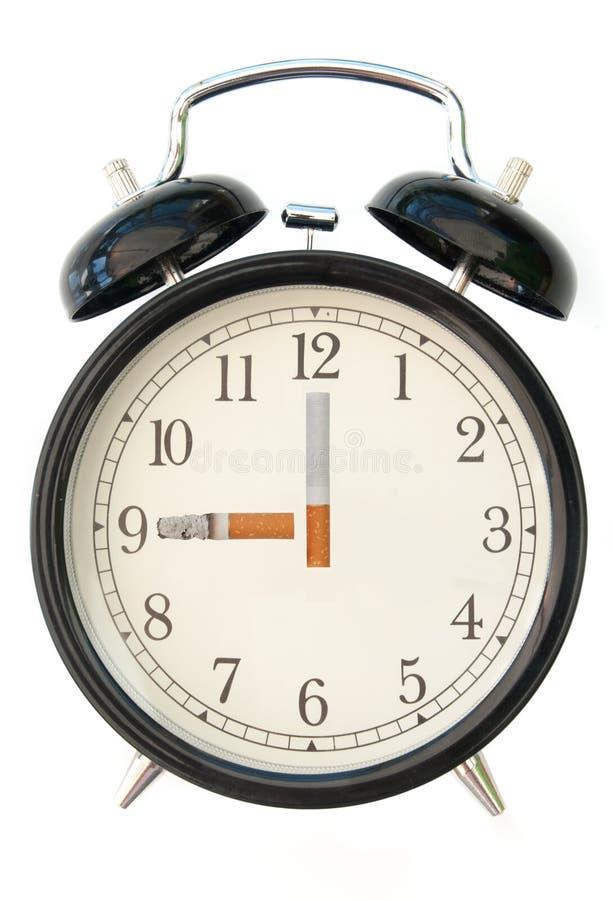 Horloge de cigarette photographie stock libre de droits