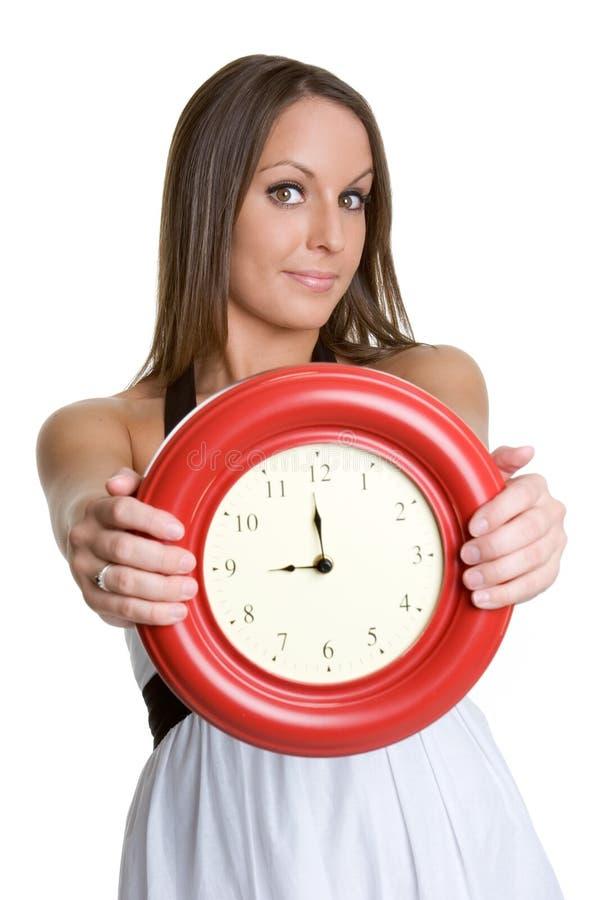 Horloge de fixation de femme photographie stock