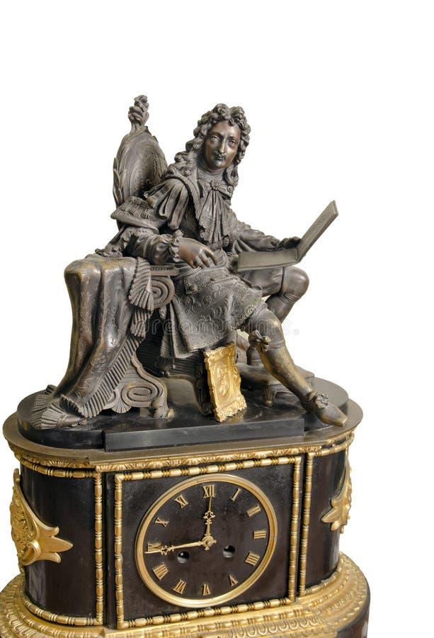 Horloge de mantel et statuette françaises antiques de roi photo stock
