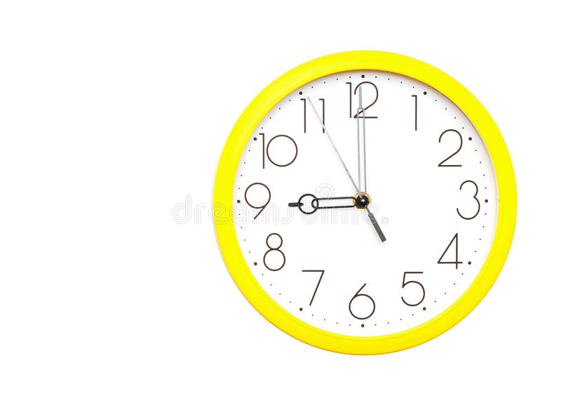 Horloge de mur jaune image libre de droits