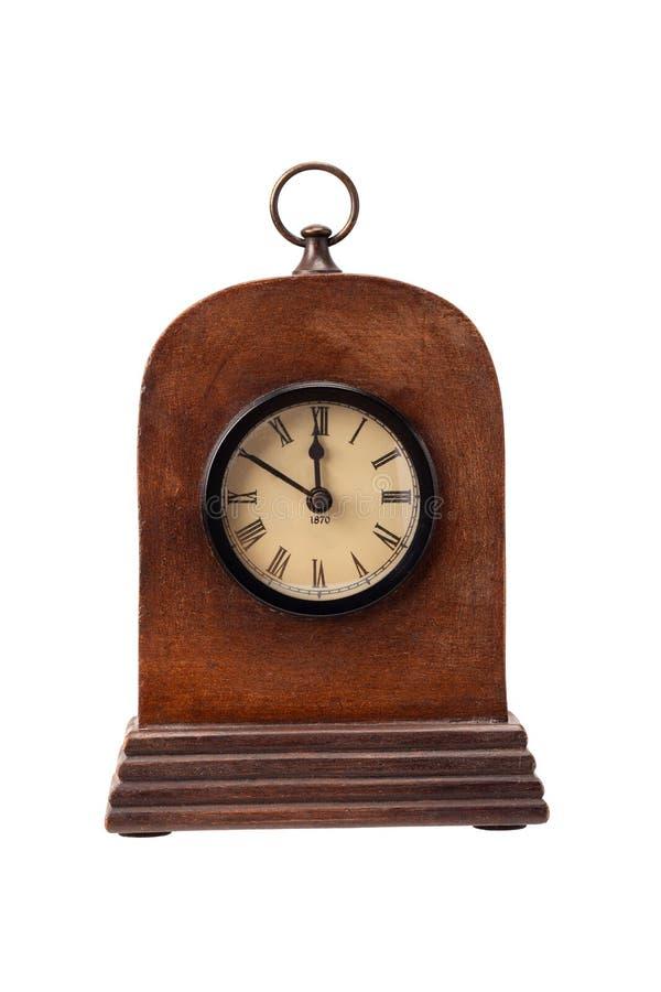 Horloge de table antique en bois sur un fond blanc photographie stock libre de droits
