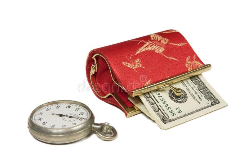 Horloge en geld stock fotografie