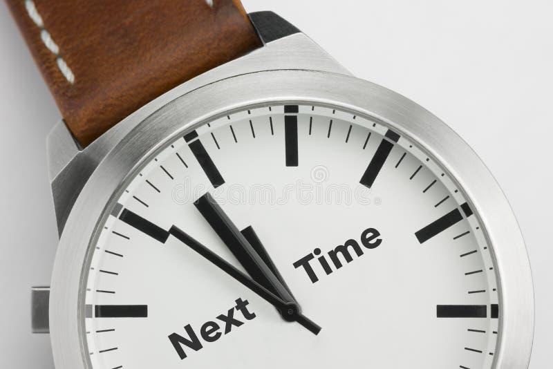 Horloge met tekst Volgende Tijd stock afbeeldingen