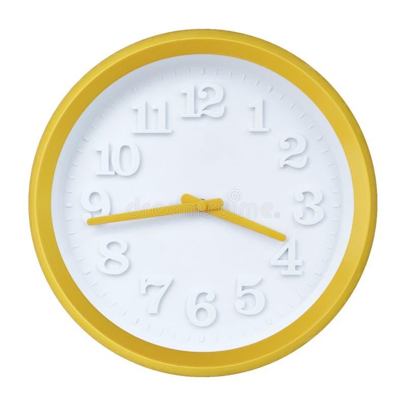 Horloge murale jaune image stock