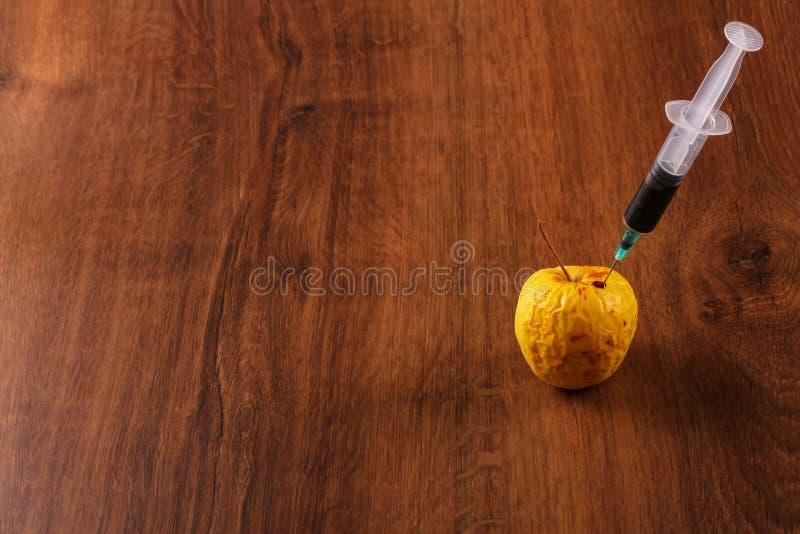 Hormoon Apple op het Hout stock fotografie