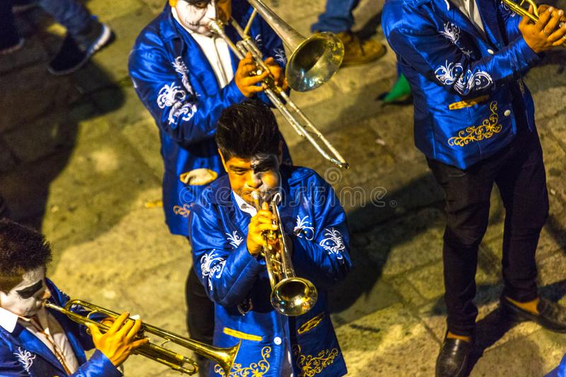Horn Players. Men play trumpets and other brass instruments in a Day of the Dead parade in Oaxaca, Mexico royalty free stock photos