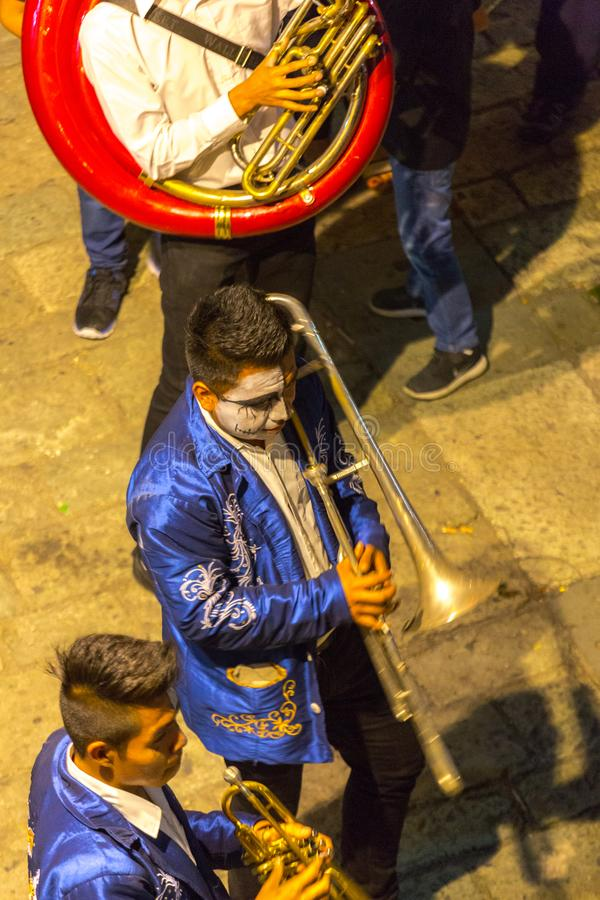Horn Players. Men play trumpets and other brass instruments in a Day of the Dead parade in Oaxaca, Mexico stock photo
