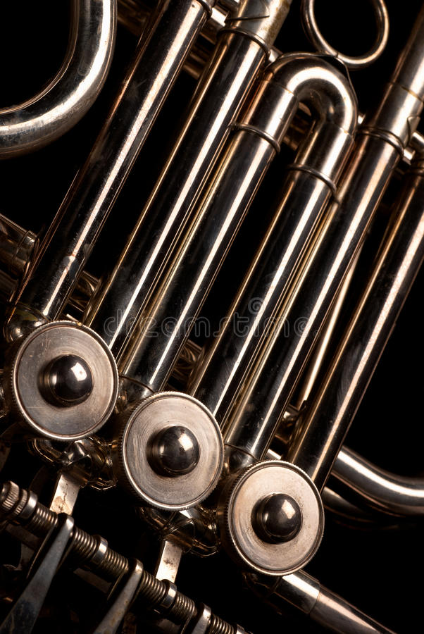 Horn tubes. Close-up of the complex tube system of a French horn stock photo