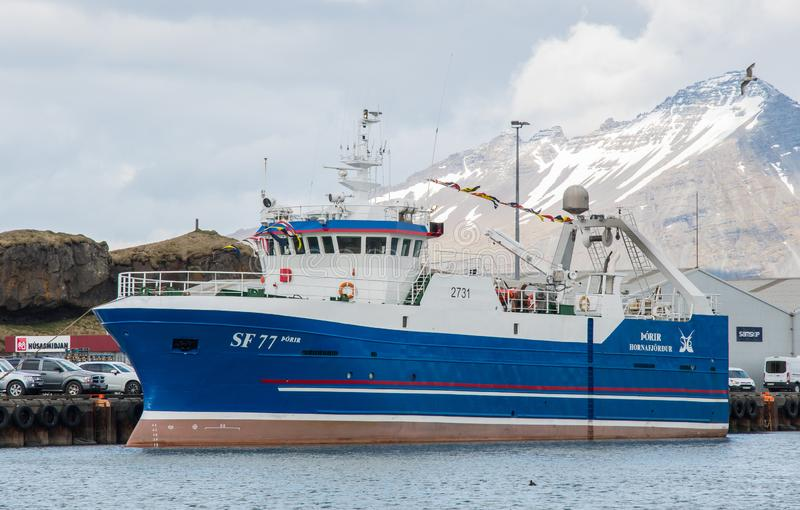 Fishing trawler Thorir SF 77 in home port of Hornafjordur after being rebuild. Hornafjordur Iceland - May 7. 2019: fishing trawler Thorir SF 77 in home port of stock photography