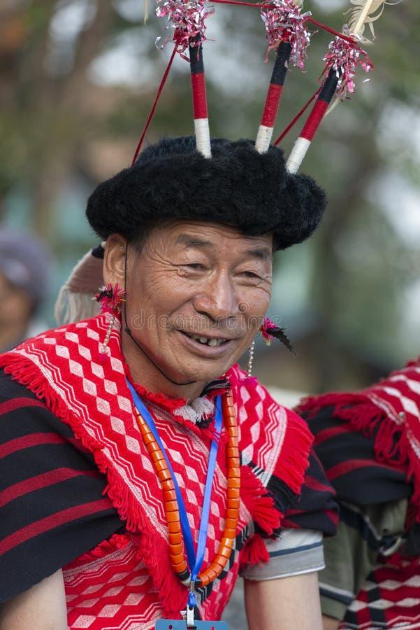 Hornbill Festival.Nagaland,India:1st December 2013 : Senior Naga Tribal Man shares a smile at Hornbill Festival. Hornbill Festival.Nagaland,India:1st December stock photo