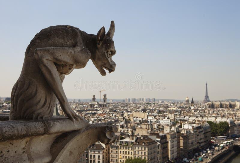 Horned Gargoyle With Eiffel Tower stock images