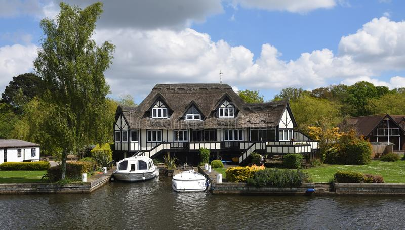 Luxury Property on the banks of the river Bure at Horning Norfolk England. royalty free stock photos