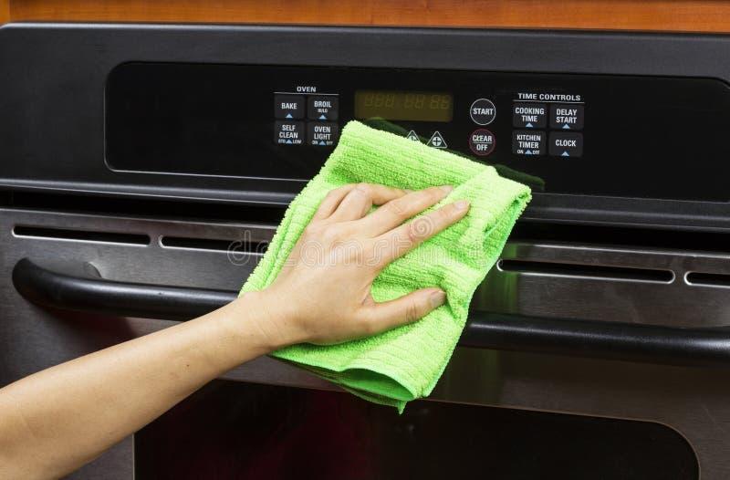 Horno de la aplicación de cocina de la limpieza foto de archivo libre de regalías