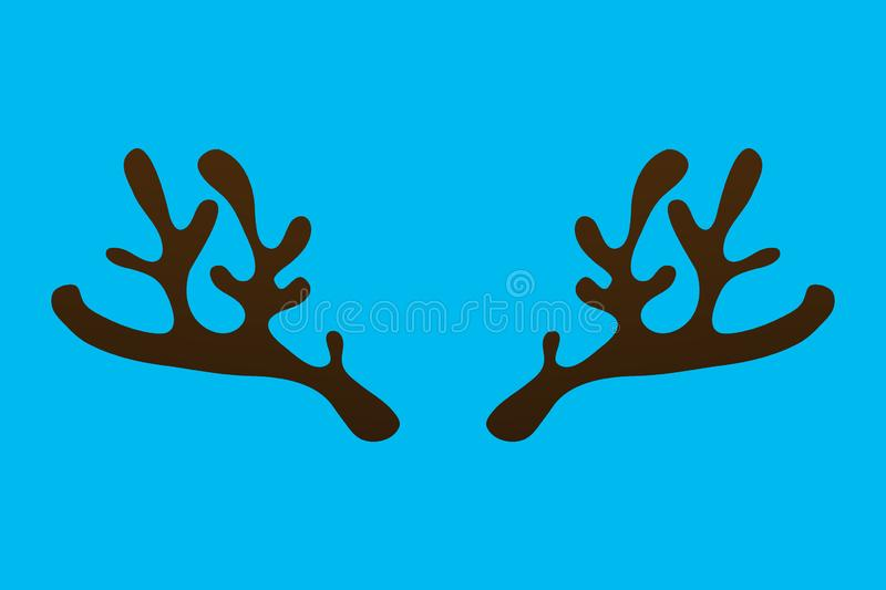 Horns of a reindeer on a blue background stock photo