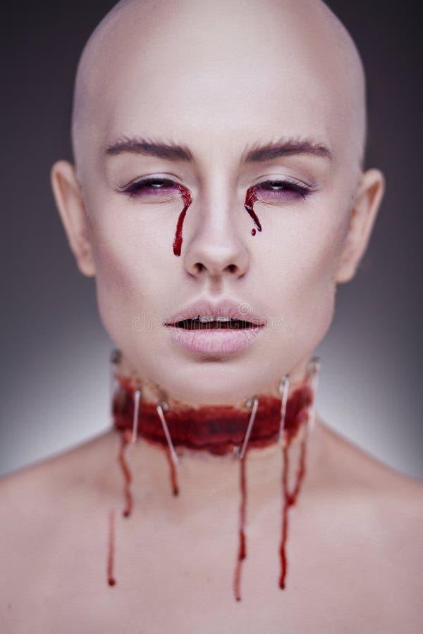 Horrible scary zombie woman. Halloween makeup. stock image