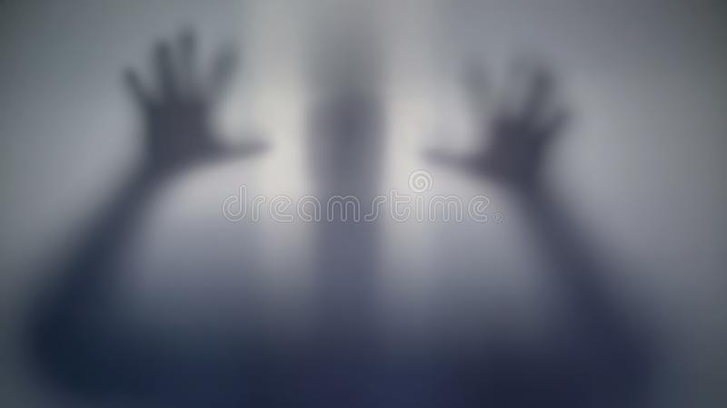 Horrible silhouette behind film, scary supernatural alien, strange creature stock photos