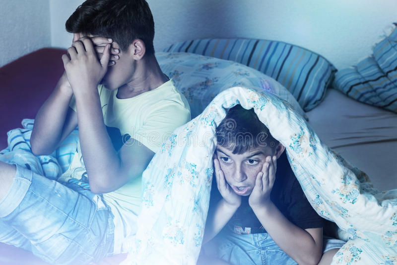 Download Horrified kids watching tv stock photo. Image of room - 47275440