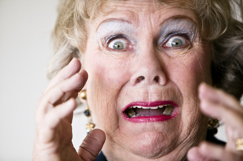 Horrified Senior Woman. Close-up of a horrified senior woman with her mouth open stock images