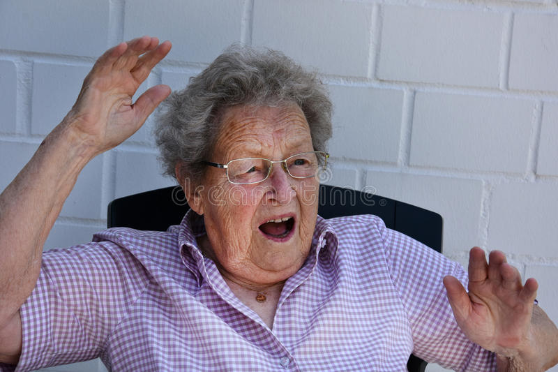 Horrified senior woman. Close-up of a horrified senior woman with her mouth open royalty free stock image