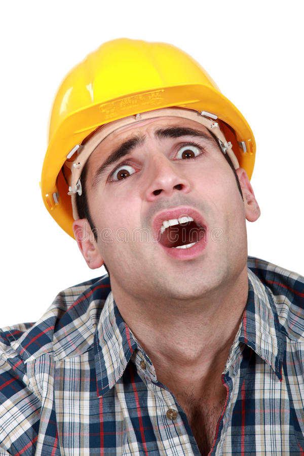A horrified tradesman. Keeps getting things wrong royalty free stock images