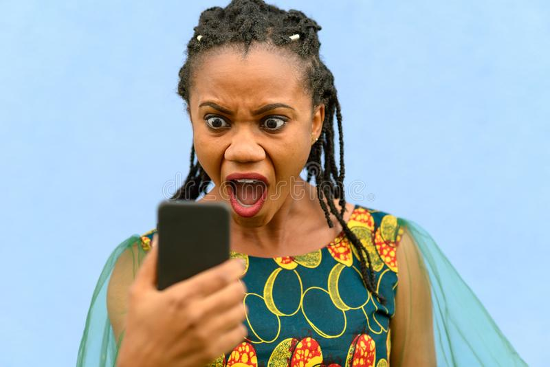 Horrified upset young African American woman stock photo